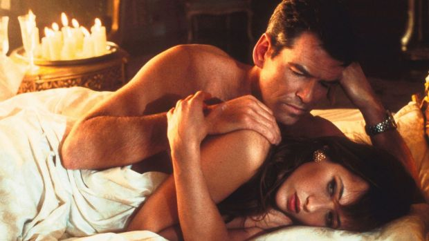 The misogynist dinosaur meets resistance: Pierce Brosnan  and Sophie Marceau as Elektra King in <i>The World Is Not ...