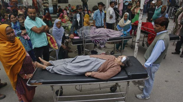 Patients outside of a government hospital after a strong tremor was felt in Jammu, India.