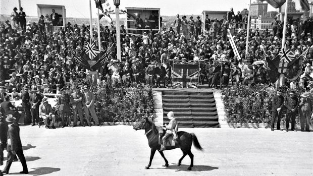 Lennie Gwyther, nine, on his pony Ginger Mick, passing the official dais at the opening of the Sydney Harbour Bridge, 1932.