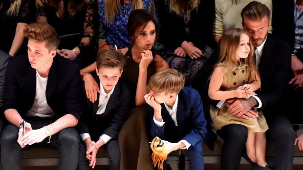 Following Posh's lead: Romeo is a pint-sized Burberry model, while Brooklyn wants to be a photographer.