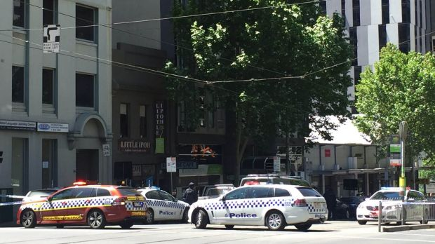 Police surround the La Trobe Street restaurant.