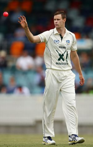 Jason Behrendorff of the Prime Minister's XI prepares to bowl with the pink ball during the tour match against New Zealand.