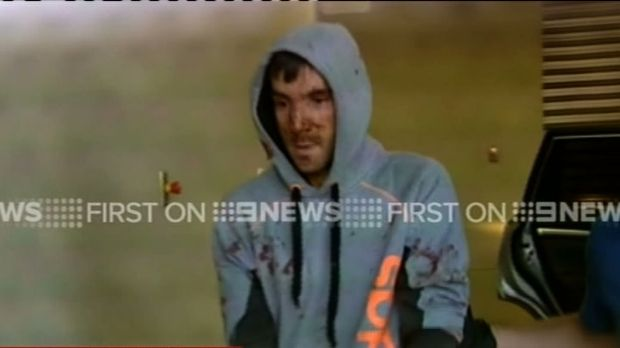 Mark Stocco in police custody at Dubbo police station on Wednesday.
