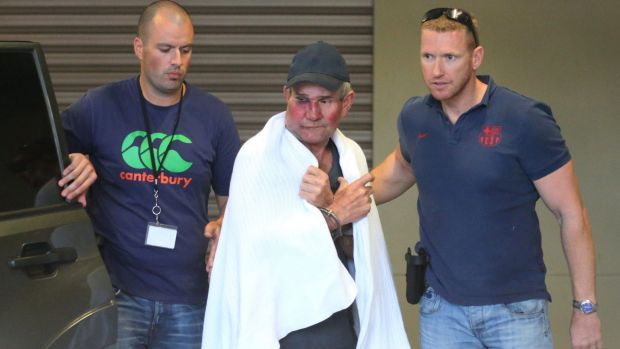 Gino Stocco is taken into Dubbo police station in October 2015.