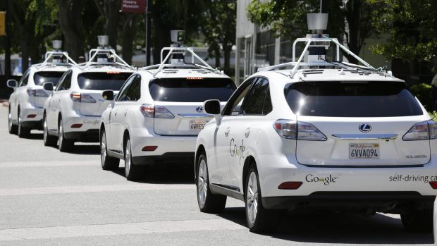 A row of Google self-driving cars stands outside the Computer History Museum in Mountain View, California.