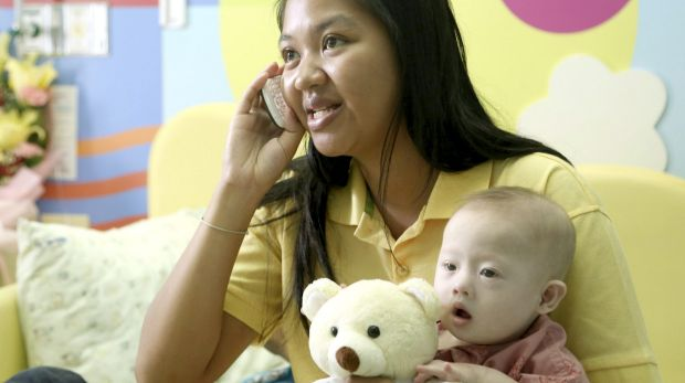 Pattaramon Chanbua with her son Gammy in 2014. The Baby Gammy scandal led to Thailand closing surrogacy clinics.