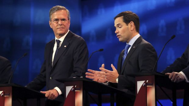 Marco Rubio speaks as Jeb Bush, left, listens during a debate of Republican presidential hopefuls at the University of ...