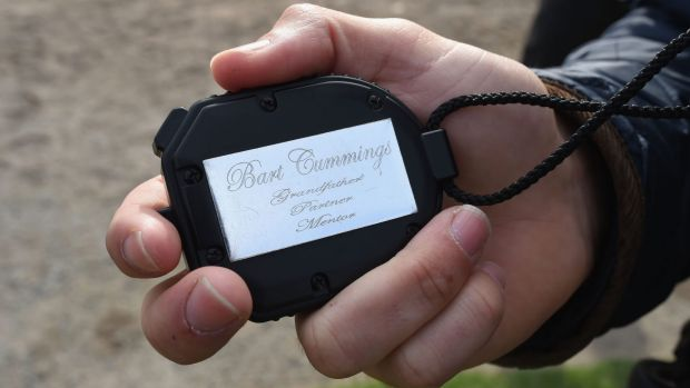 Bart time: Trainer James Cummings holding Bart Cummings' famous stop watch at Flemington on Thursday morning.