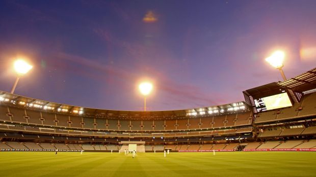 The lights come on at dusk at the MCG.