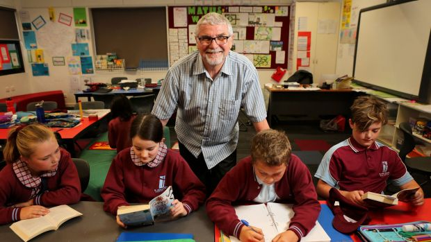 Switched: Michael Higgins, with some of his grade 5 students. The former engineer went into teaching at an age when some ...