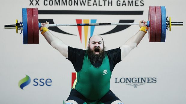 Weight of expectation: Damon Kelly wins bronze at the Glasgow Commonwealth Games.