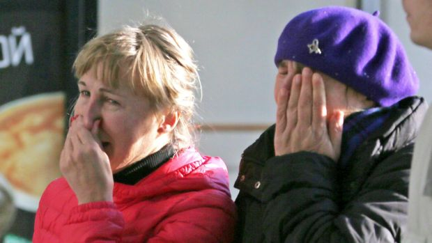 Relatives of the victims of a Russian airliner which crashed in Egypt arrive at Pulkovo airport in St Petersburg.