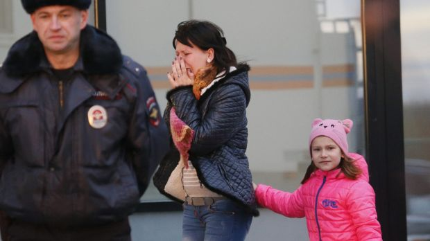 Distraught: A relative arrives at at a hotel near St. Petersburg's Pulkovo airport where relatives have gathered.