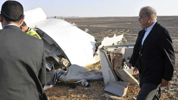 Egypt's Prime Minister Sherif Ismail, inspects the remains of the crashed passenger jet.