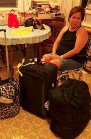 Rhed de Guzman after she arrived in the US, having been unsuccessfully scammed in the Philippines.