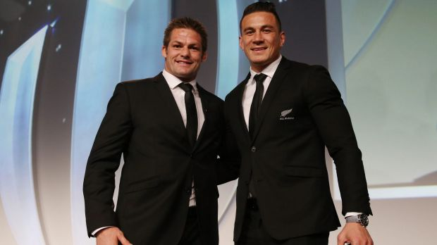 Former teammates: Richie McCaw presents Sonny Bill Williams with his replacement medal, after he gave his original medal ...