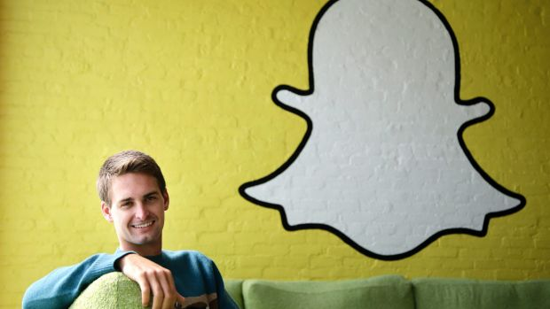 Snapchat co-founder Evan Spiegel, with the company's logo. The Venice, California, start-up relies on advertising to ...