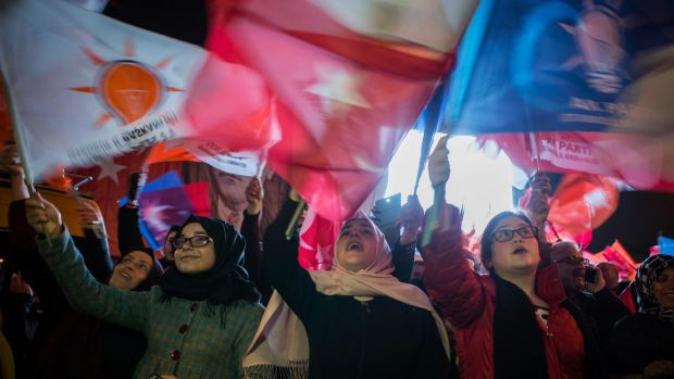 Supporters of the Justice and Development Party, also known as AK Party or AKP, celebrate following the result of the ...