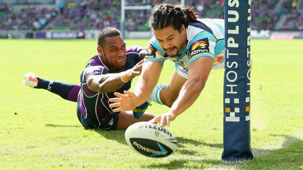 Kevin Gordon scores a try for the Titans in a 2014 match against the Melbourne Storm.
