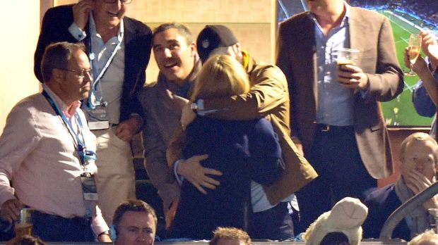 A warm embrace: Kylie Minogue and Joshua Sasse at the Rugby World Cup on Saturday.