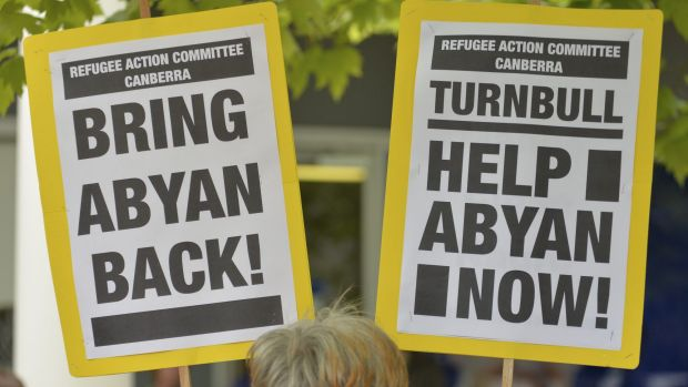 Signs at a rally in Canberra urge support for Somali woman and  Nauru asylum seeker Abyan who claims to have been raped, ...