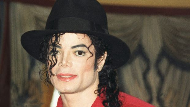 Michael Jackson poses at a press conference before a date on his HIStory world tour in 1996.