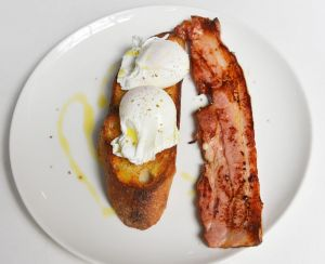 Poached eggs on toast with thick-cut bacon at Pei Modern.