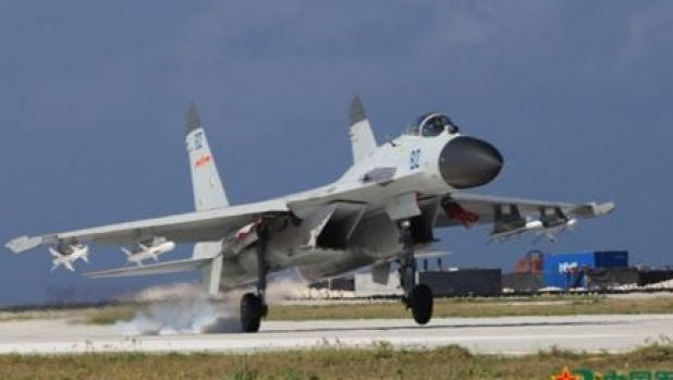 A J-11 fighter takes off for exercises over South China Sea.