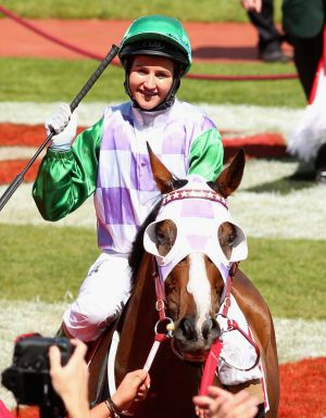 Payne makes history as the first woman to ride a horse to Melbourne Cup victory.