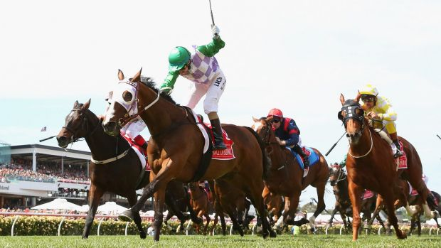Michelle Payne rides to the front on Prince of Penzance to win the Melbourne Cup on Tuesday.