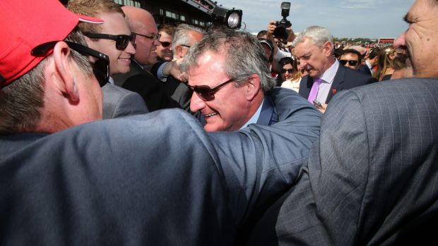 Winning trainer of Prince of Penzance Darren Weir is mobbed in the mounting yard moments after winning The  Melbourne ...