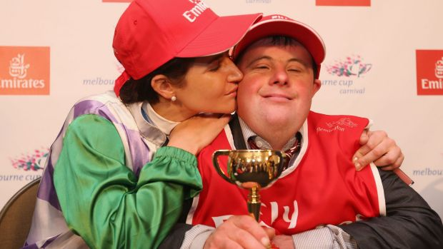 Michelle Payne celebrates her winning ride with brother and strapper Steven Payne.