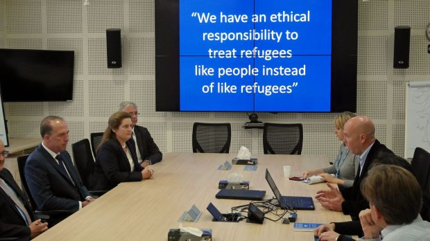 Immigration Minister Peter Dutton is briefed on United Nations humanitarian work in Amman.
