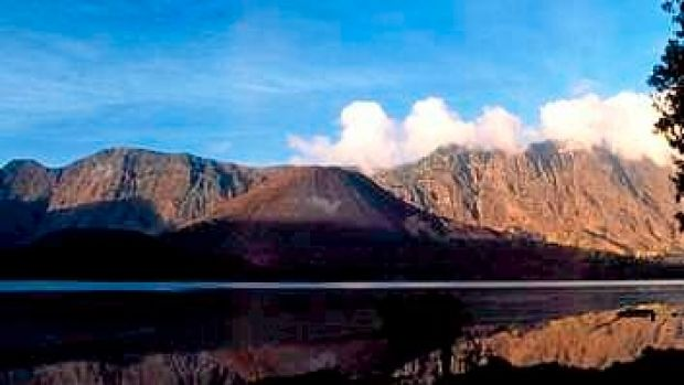 Mount Rinjani spews clouds of gas on Lombok island, east of Jakarta, Indonesia.