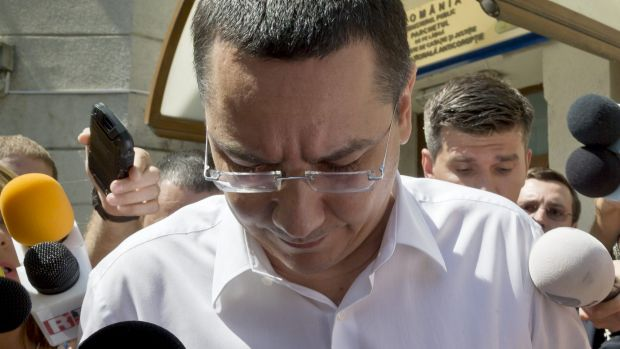 Romanian prime minister Victor Ponta exits the national anti-corruption prosecutors office last year.