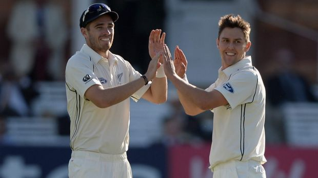 Trent Boult and Tim Southee celebrate a wicket during the tour of England.