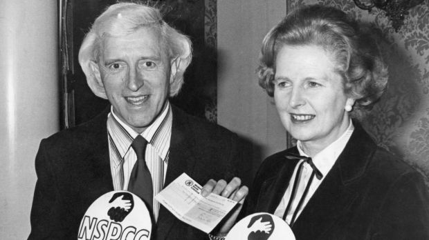 British Prime Minister Margaret Thatcher with English DJ television presenter Jimmy Savile at a fundraising event in 1980.