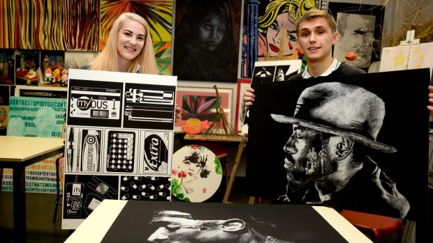 Dulwich High School students Lucy Howroyd and Thomas Carman with their art.