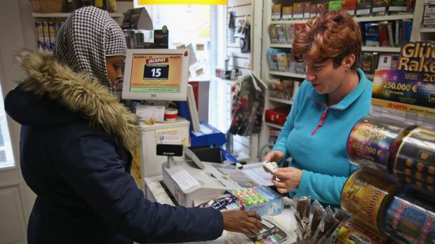 Warda Abdi, 23, an asylum-seeker from Somalia, buys a pack of cigarettes in Bad Belzig, Germany.