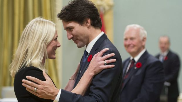 Canadian Prime Minister Justin Trudeau hugs Environment and Climate Change Minister Catherine McKenna after the new ...