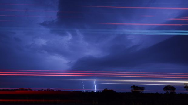 Lightning and truck lights combine as a big storm moved through western NSW on Wednesday.
