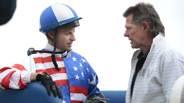 Trainer Garry Clarke speaks to Oh So Adorable's jockey Richard Bensley after a win at Queanbeyan.