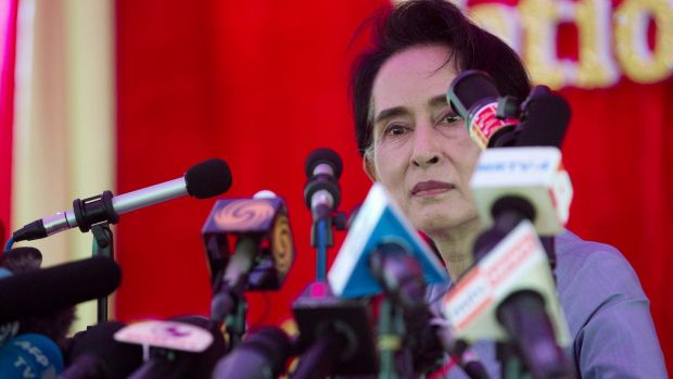Nobel Laureate Aung San Suu Kyi addresses the media at her home in Yangon, Myanmar on Thursday.