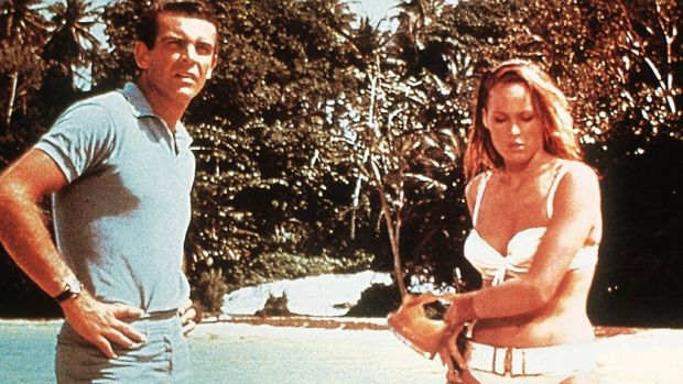 """""""Nobody knew anything about him."""" Sean Connery and Ursula Andress in a scene from """"Doctor No"""" (1963)."""