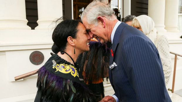 Prince Charles, welcomed with a hongi from New Zealand Defence Force Flight Sergeant Wai Paenga.