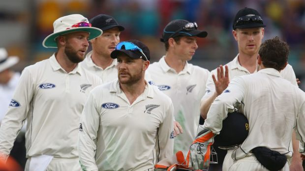 Up against it: Brendon McCullum leads his team from the field after the first day's play.