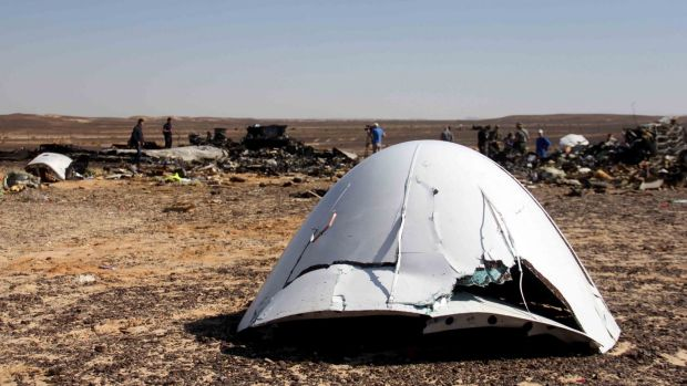 Debris of a Russian airplane is seen at the site a day after the passenger jet bound for Russia crashed in Egypt.