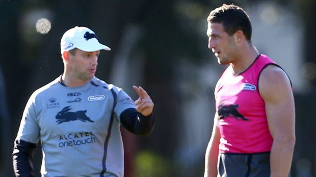 Close bond: Michael Maguire talks with Sam Burgess at training.