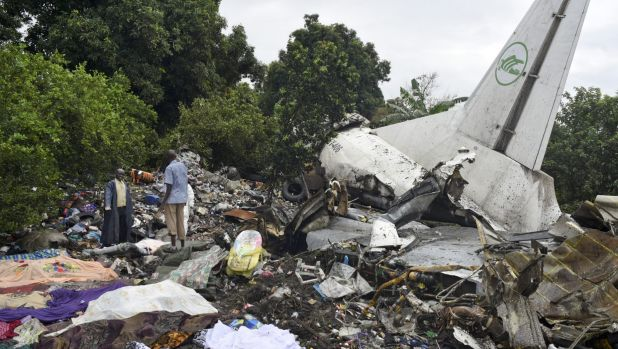 Responders pick through the wreckage of a cargo plane which crashed in  Juba, the capital of South Sudan.