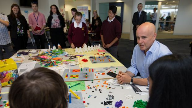 NSW Minister for Education, Adrian Piccoli, with students from Campbelltown Performing Arts School, in one of the ...